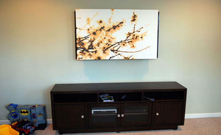 Esconda a TV com uma obra de arte
